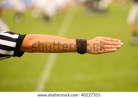 Hand of a referee showing to the right - stock photo