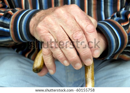 hand of a senior man holding a cane