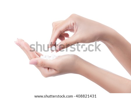 hand of a woman holding a pill, isolated on white with clipping path - stock photo