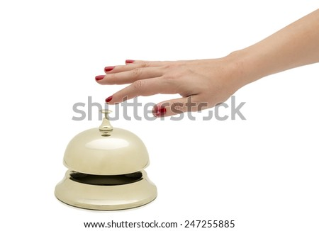 Hand of a woman ringing hotel bell isolated on white background.