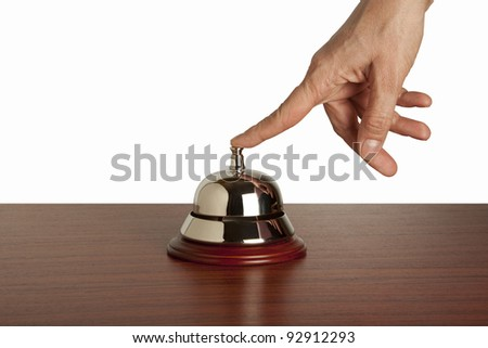 Hand of a woman using a hotel bell  isolated - stock photo