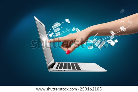 Hand of a young woman touch laptop screen icons around. Communication concept. - stock photo