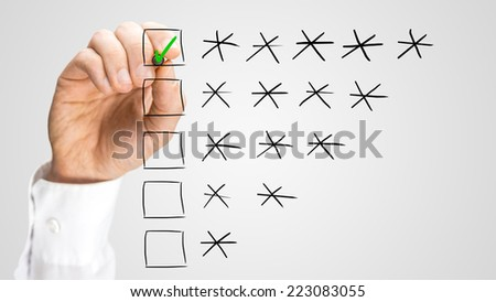 Hand of an inspector or reviewer ticking the highest ranking on a virtual screen, during a quality control or evaluation. - stock photo