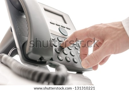 Hand of an operator dialing a phone number. Isolated over white background. - stock photo