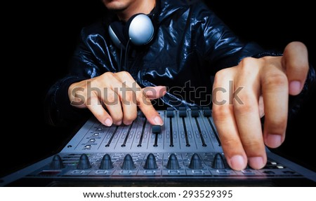audio engineer stock photos royalty images vectors hand of asian handsome dj producer working on digital studio mixer for night club