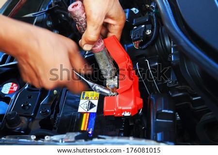 Hand of auto mechanic. Car repair service - stock photo