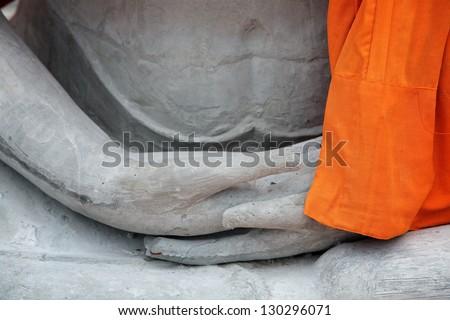 hand of buddha statue. - stock photo
