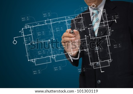 Hand of Business Man Draw architect or home plan - stock photo