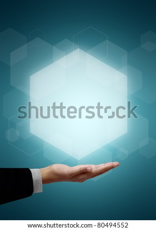 Hand of business man have Hexagon above on green background. - stock photo