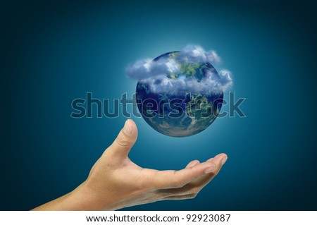 Hand of business man hold earth globe - stock photo