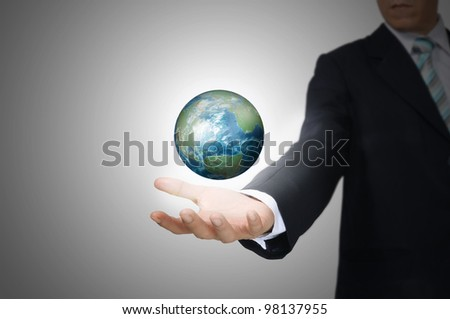 Hand of Business Man Hold Earth Globe.  Elements of this image furnished by NASA - stock photo