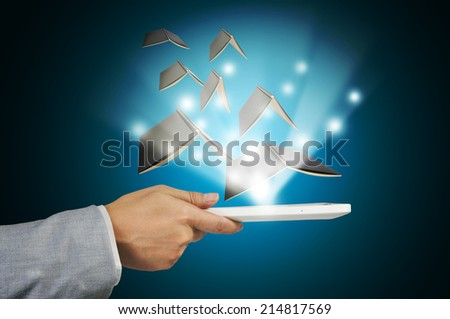 Hand of Business Man hold tablet using Book Data as E-book concept