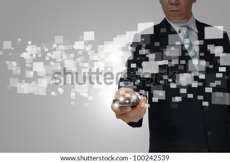 Hand of Business Man Hold touch screen of smartphone sending digital data. - stock photo