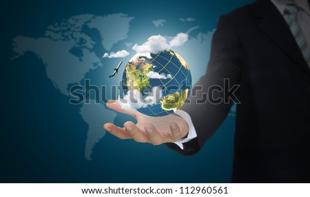 Hand of business man holding earth globe. Elements of this image furnished by NASA