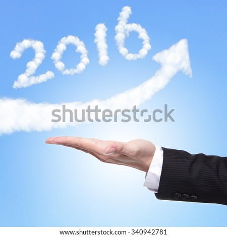 hand of Business man holding happy new year 2016 (white cloud and blue sky on sunny day) on his hand - stock photo
