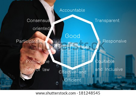 Hand of business man present chart or diagram of good governance  - stock photo