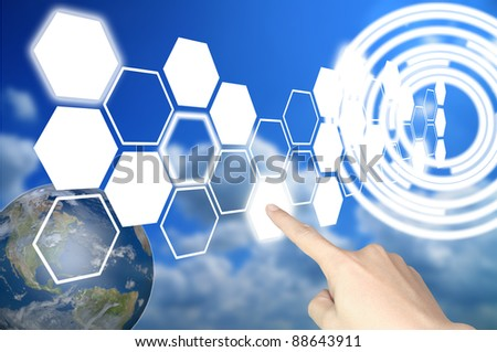 Hand of business man press hexagon button on world map or tablet pc touch screen - stock photo