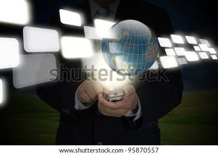 Hand of Business Man Pushing on smartphone and touch screen interface and earth globe - stock photo