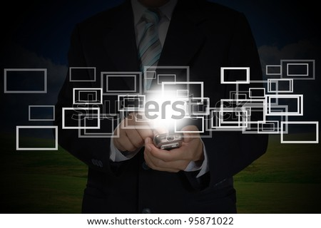 Hand of Business Man Pushing touch screen of mobile smart phone - stock photo