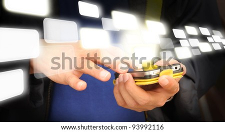 Hand of business man touch screen of mobile phone and flying digital data - stock photo