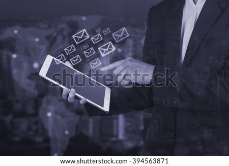 Hand of Business man use tablet ,email and network concept,cool tone