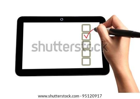 Hand of Business Man Write check mark option and box on Touch screen of Tablet PC - stock photo