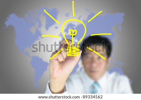 Hand of business man write light bulb on touch screen tablet - stock photo