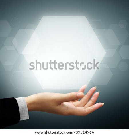 Hand of business woman have Hexagon above on gray background - stock photo