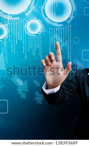 hand of business women pushing a button on a touch screen interface on background blue - stock photo