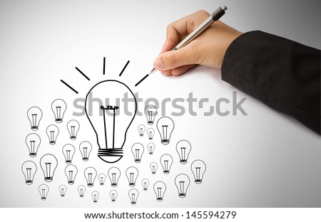 hand of business writing lamp and light - stock photo