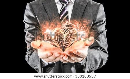 Hand of businessman , Burning Heart mark - stock photo