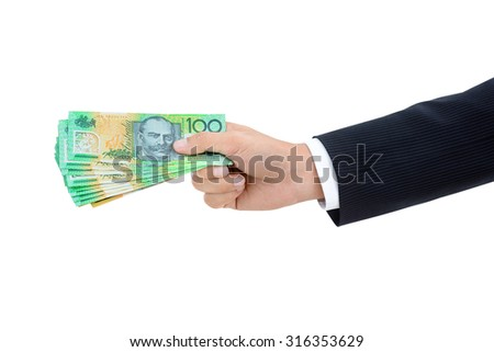 Hand of businessman giving money, Australian dollar (AUD) banknotes, on white background