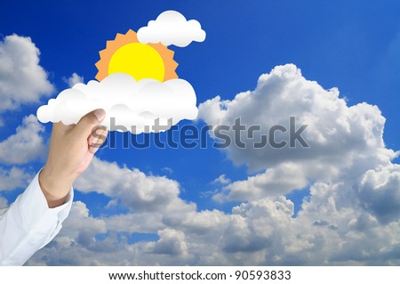 hand of businessman hold the sun and cloud to the blue sky