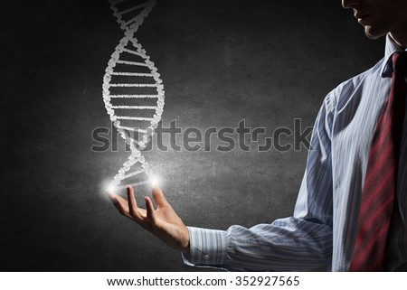 Hand of businessman holding dna molecule concept - stock photo