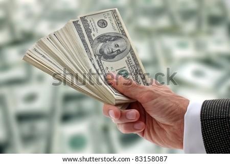 hand of businessman holding dollars - stock photo