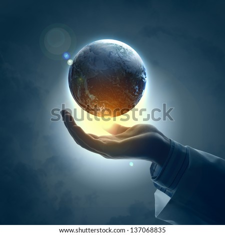 Hand of businessman holding earth planet against illustration background - stock photo