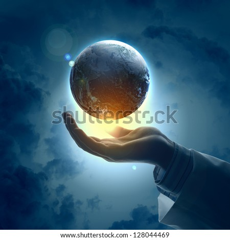 Hand of businessman holding earth planet against illustration background.Elements of this image are furnished by NASA - stock photo