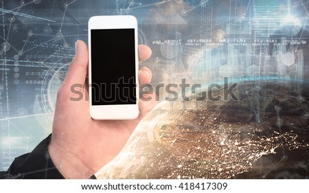 Hand of businessman holding smart phones against image of a earth - stock photo