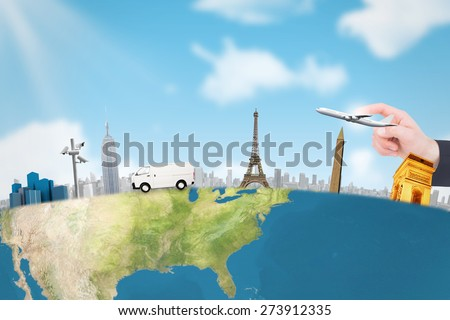 Hand of businessman in suit pointing against blue sky - stock photo