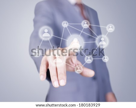 hand of businessman pressing virtual button.