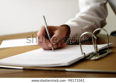 Hand of businessman signing a document or contract - stock photo