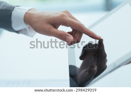 Hand of businessman using digital tablet, selective focus