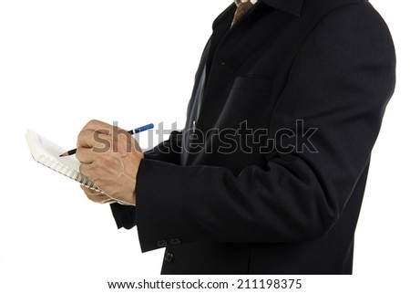 Hand of Businessman write on notebook Isolated on white