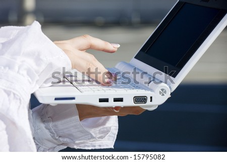 hand of businesswoman on laptop computer keyboard - stock photo