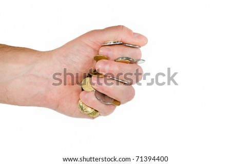 Hand of Caucasian man squeezed in fist Ukrainian coins.