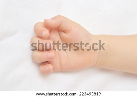 hand of child on white background - stock photo