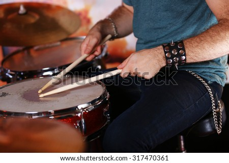 Hand of drummer  with sticks and drums, close-up - stock photo