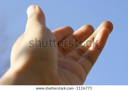 Hand of faith : A hand stretched out towards the sky, showing generosity, warmth and friendliness - stock photo