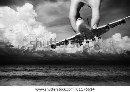 Hand of fate. Flight safety conceptual theme. - stock photo