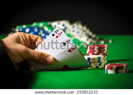 Hand of four aces in poker - stock photo